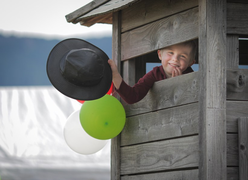 little boy holding hat