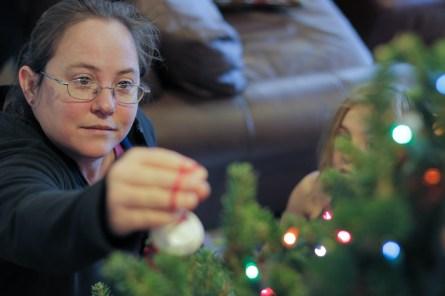 Mom decorating Christmas tree