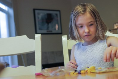 little girl building Legos