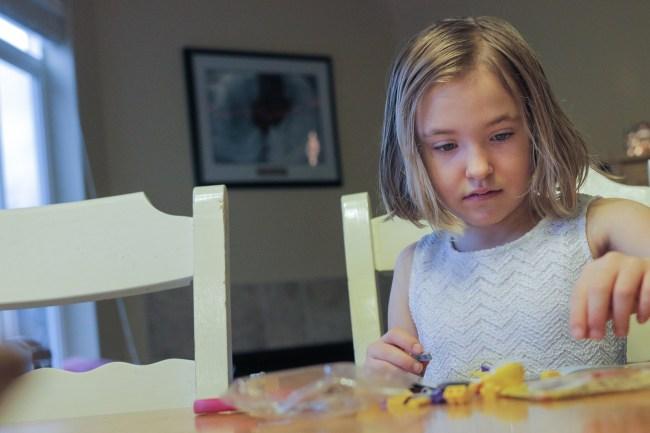 little girl building Legos