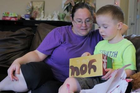 son showing Mom Christmas present