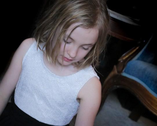 little girl black background