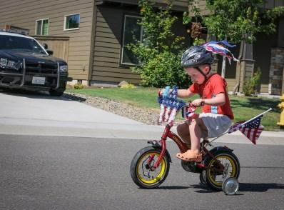 little boy riding bike