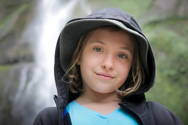beautiful little girl with Multnomah Falls in background