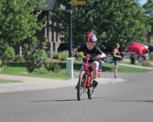 little boy determined riding bike