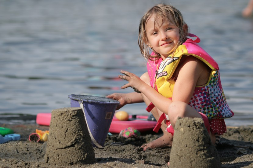 girl playing with sand toys