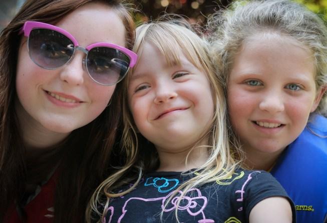 three cousins smiling