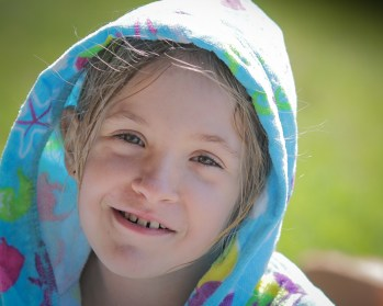 little girl with towel hood