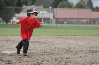boy running bases