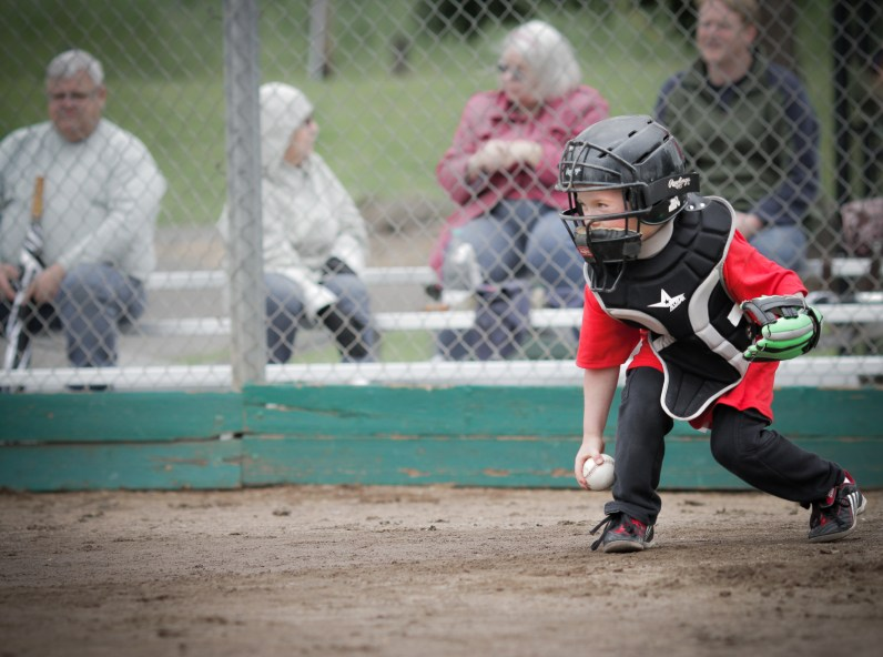 little boy playing catcher