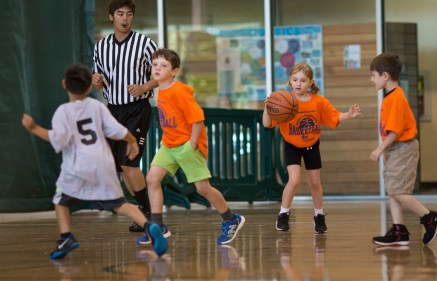 girl dribbling basketball