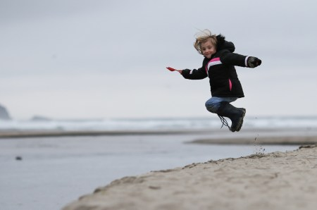 girl in air at beach