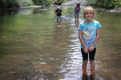 little girl standing in water