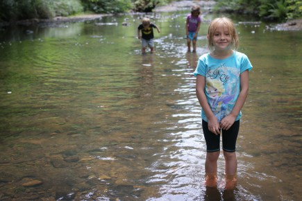 little girl standing in water