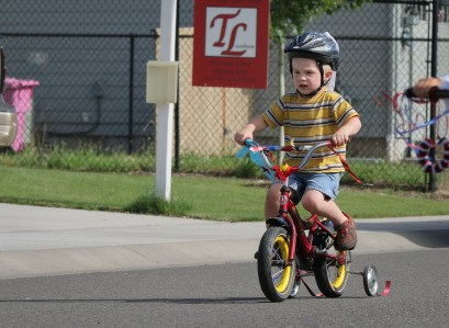 evan riding bike with training wheels