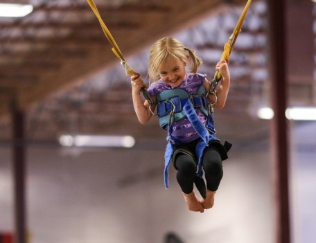 little girl on bungees