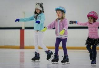 little girl balancing ice skating