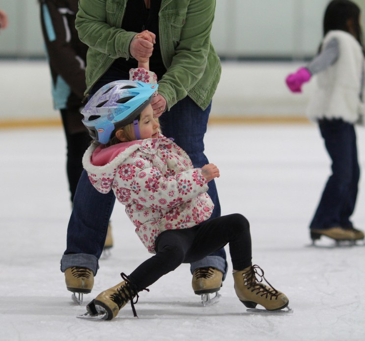 little girl falling ice skating