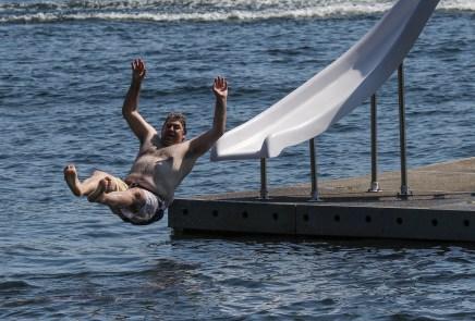 man airborne off water slide