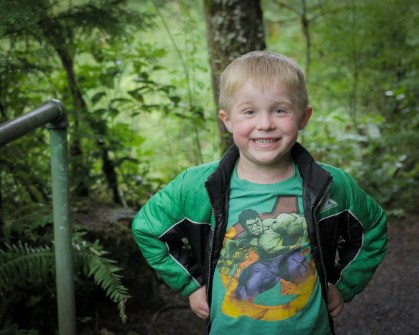 smiling boy in woods