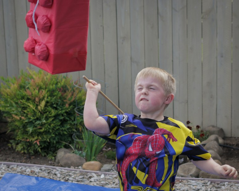 little boy hitting pinata