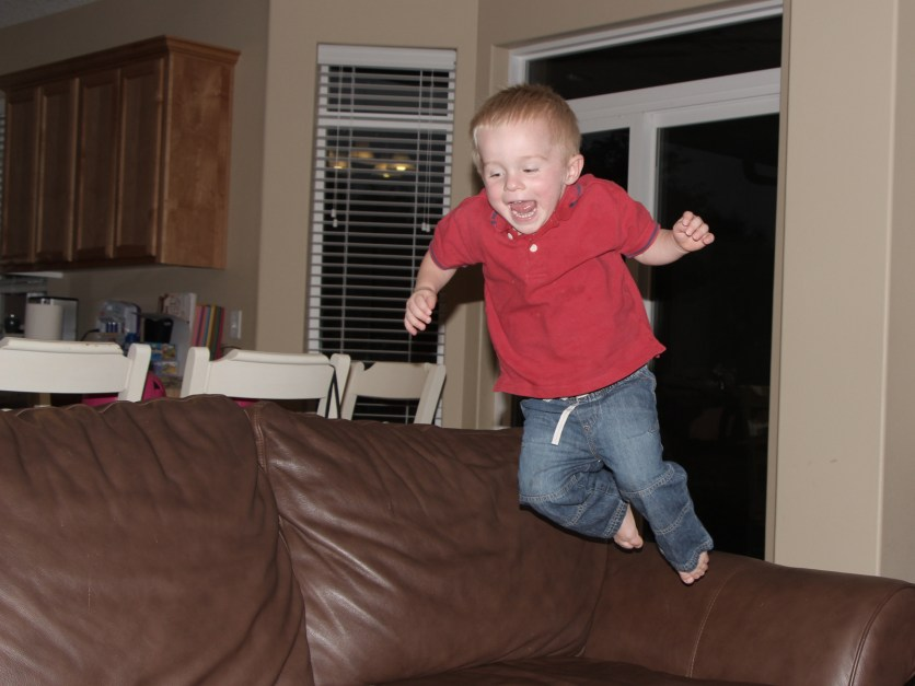 little boy airborne off couch
