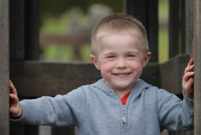 little blond boy big smile