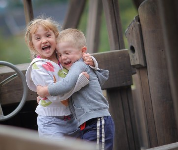 brother and sister big hug and smiles