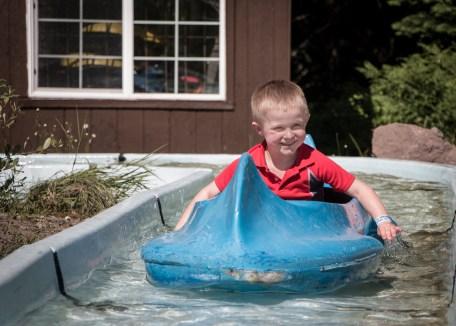 little boy in blue canoe