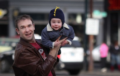 dad holding kid in front of Powell's Books