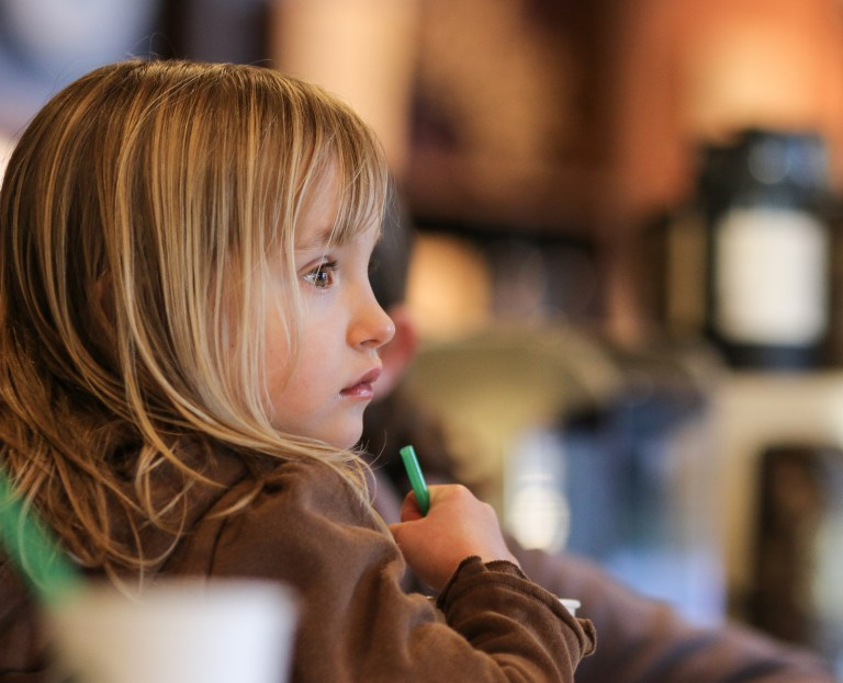 little girl portrait in starbucks