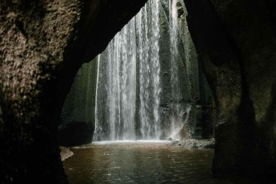waterfall flowing in rocky ravine