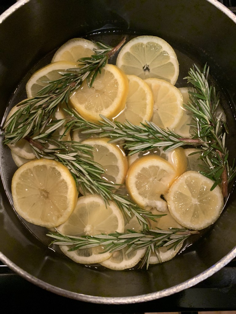 rosemary and lemon steeping in a pot