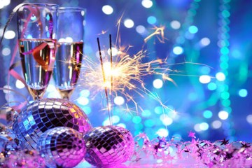 Champagne flutes and New Year's decorations