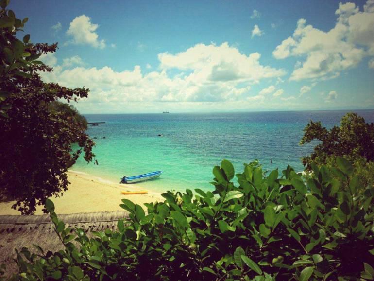 Alegre Beach Resort and Spa's fine white sand beachfront, where aqua sports equipment are available.