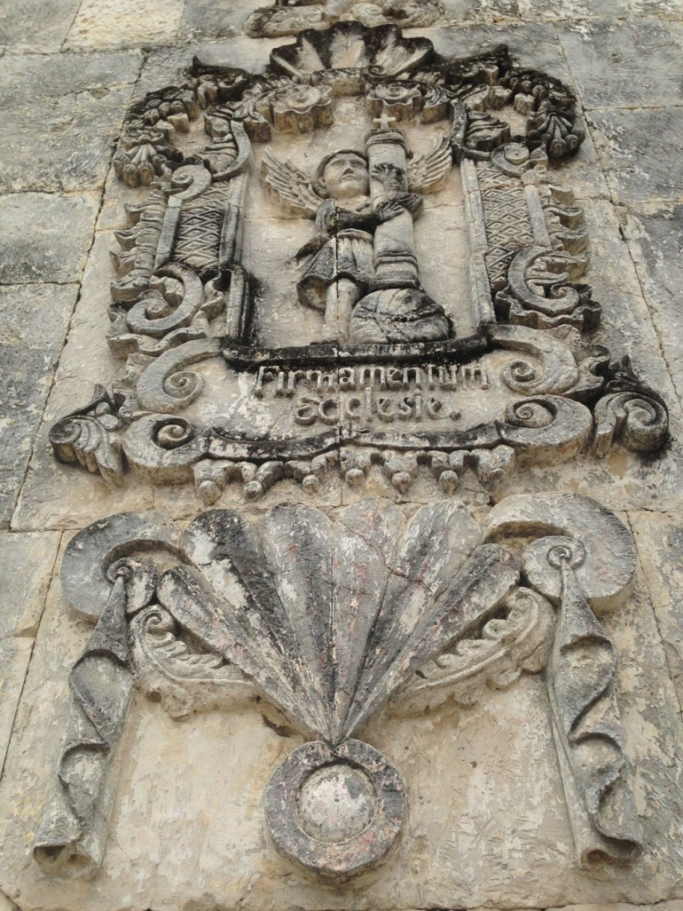 An example of the bas reliefs of angels and other Christian symbols that adorn the Argao church's facade.
