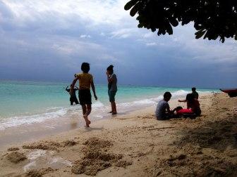 Kids at play on Lambug Beach in Badian