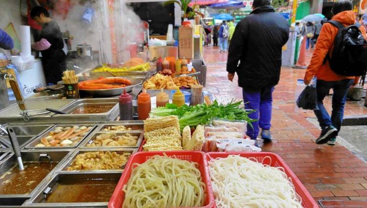 STREET FOOD. Old school noodles on the street that sells the latest gadgets.