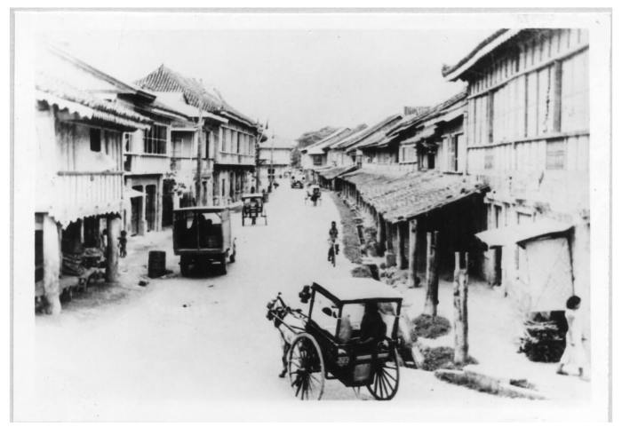 OLD COLON. This archival photo shows the corner of Mabini and Colon streets. This is the point of view were you to stand across the obelisk that stands on Colon. According to the text that accompanied this photograph at the Cebuano Studies Center of the University of San Carlos, the building at the end of the road used to Hijos del Pueblo. It is where the present-day Gaisano Main is located.