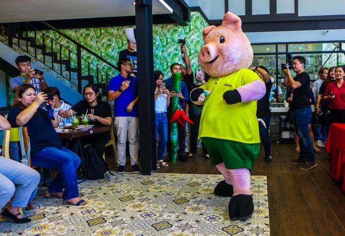 Rico's Lechon's mascot entertains bloggers and journalists who covered the media preview.