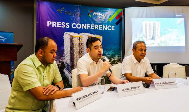 VERTEX COAST PRESS CONFERENCE. Priland President Ramon Carlo Yap (center) talks to reporters about Vertex Coast in Punta Engaño in Mactan. With him are Priland Sales Manager Irvin Paul Pastoriza (left) and Priland Chief Operating Officer Marcelino Relampagos.