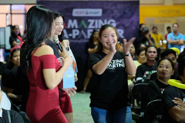 A lucky Ka-Partner retailer wins a raffle prize during the convention in Leyte.