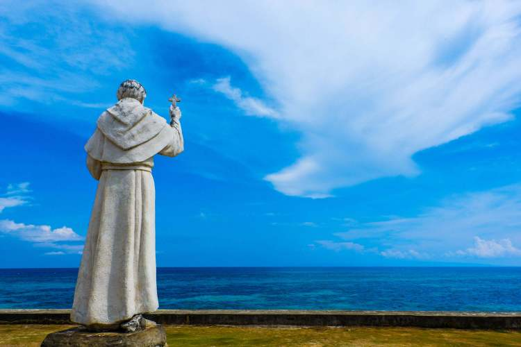 FR. JULIAN BERMEJO looks out to sea. Out there is Sumilon Island where his fleet of Boljoanons defeated Moro raiders led by Gorandeng in 1813. They decapitated the leader and hang his head on the mast. After that decisive victory, raids on Boljoon stopped.
