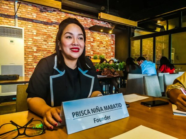 PINOYCARE. Prisca Niña Mabatid, Pinoycare founder, talks to reporters about her company, which has been operating since 1999 and provides visa services for Filipinos who seek better opportunities outside the Philippines.