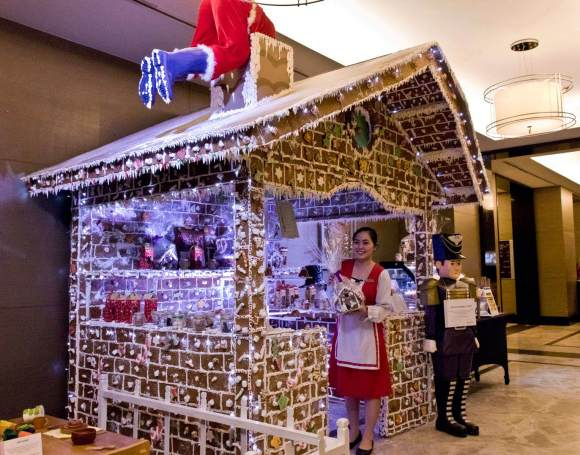 Hansel & Gretel's House is a life-size gingerbread house delightfully and deliciously covered using real sweets and candies, where guests may choose and shop for holiday pastries including ube ensaymada, fruitcake, stollen, panettone, banana loaf, rum cake, cookies, crinkles and more.