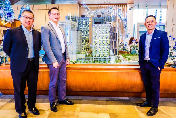 MANDANI BAY QUAY. Project Advisor Jeffrey Lun, Project Director Gilbert Ang, Sales Head Audrey Villa at a scale model of the Mandani Bay development during the announcement of their third and last residential tower in the second phase of the waterfront development.