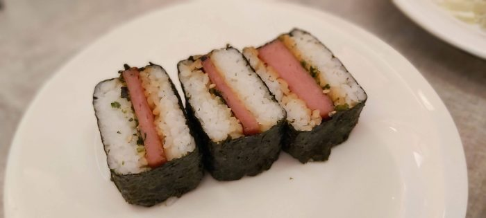 SPAM MUSUBI. This is a popular snack in Hawaii. The dish is made of spam on top of a block of rice and wrapped with nori.