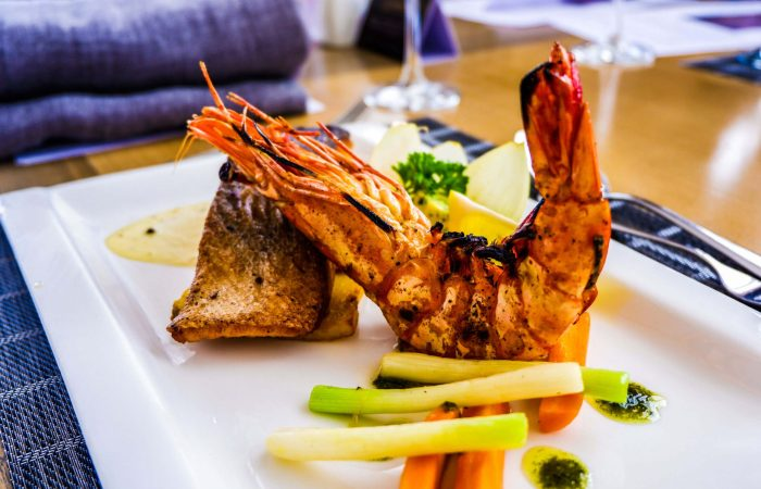 THE LOVE BOAT. Pan seared salmon and prawn combination served with herbed butter and lemon garlic sauce.
