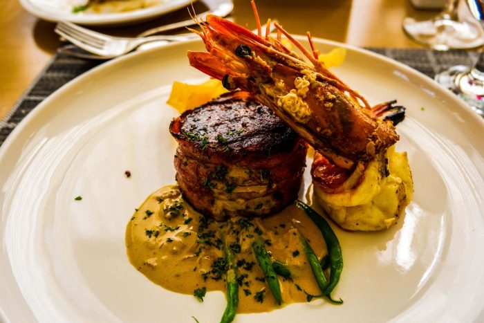 YIN & YANG. Fillet mignon with grilled prawn and crispy layered potatoes. The dish is of wagyu fillet mignon and prawn grilled and seasoned to perfection, served with mushroom sauce.