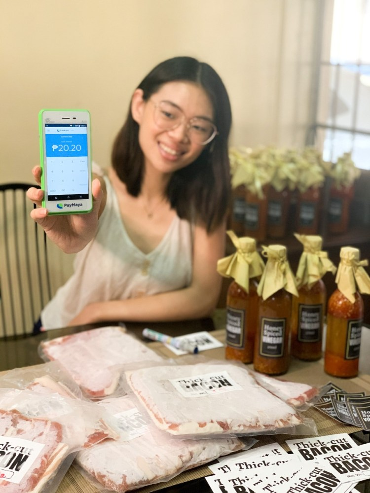 Entrepreneur Charmaine De Leon showcases her store's PayMaya One Lite device which enables her to accept card and eWallet payments from customers - promoting safer and more convenient transactions in the new normal.
